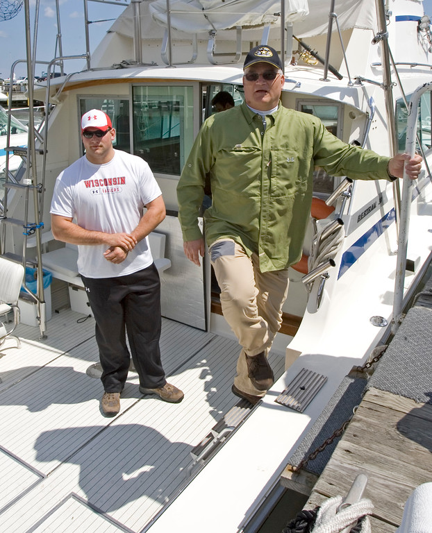 . Cleveland Browns first round draft pick Joe Thomas, left, gets off a fishing charter with his father Eric Saturday, April 28, 2007, in Port Washington, Wis. Thomas spent day fishing with his dad instead of attending the football draft in New York. Thomas, an offensive lineman from Wisconsin, was was selected third overall by the Browns.  (AP Photo/Morry Gash)