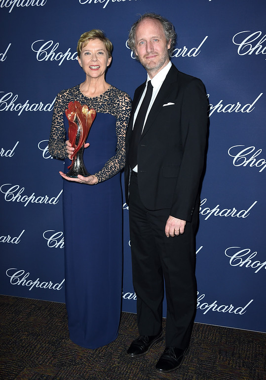 ". Annette Bening, winner of the Career Achievement award for ""20th Century Women, \"" poses backstage with presenter Mike Mills at the 28th annual Palm Springs International Film Festival Awards Gala on Monday, Jan. 2, 2017, in Palm Springs, Calif. (Photo by Jordan Strauss/Invision/AP)"