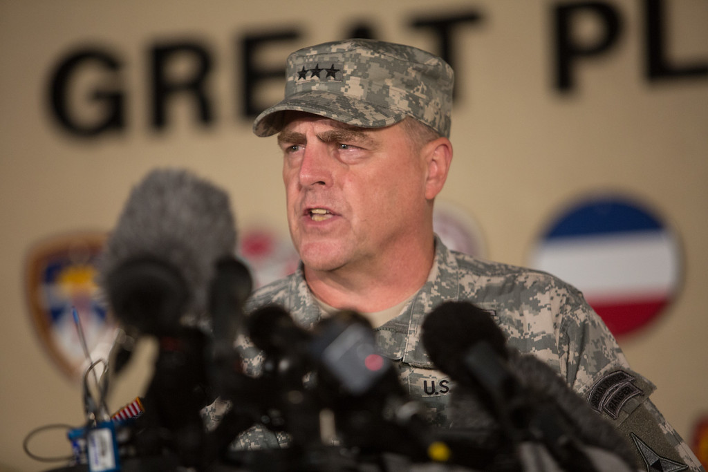 . Lt. Gen. Mark Milley, the senior officer on base, speaks with the media outside of an entrance to the Fort Hood military base following a shooting that occurred inside, Wednesday, April 2, 2014, in Fort Hood, Texas. Four people were killed, including the gunman, and 16 were wounded in the attack, authorities said. (AP Photo/Tamir Kalifa)