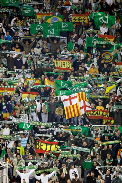 Real Betis fans. Taken during the football derby between Sevilla FC and Real Betis Balompie that took place in Sanchez Pizjuan stadium on 7 Feb 2009, Seville, Spain.