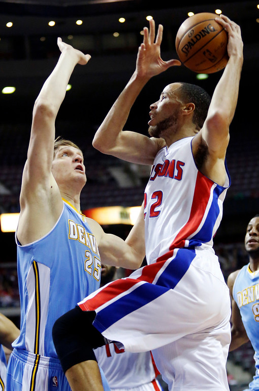. Detroit Pistons forward Tayshaun Prince (22) goes to the basket against Denver Nuggets center Timofey Mozgov (25) in the first half of an NBA basketball game, Tuesday, Dec. 11, 2012, in Auburn Hills, Mich. (AP Photo/Duane Burleson)