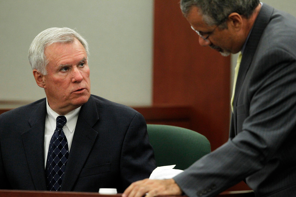 . Former Clark County Chief Deputy District Attorney and O.J. Simpson trial prosecutor Chris Owens is questioned by Simpson defense attorney Ozzie Fumo during an evidentiary hearing for Simpson in Clark County District Court on Tuesday, May 14, 2013 in Las Vegas.  The hearing is aimed at proving Simpson\'s trial lawyer, Yale Galanter, had conflicted interests and shouldn\'t have handled Simpson\'s case. Simpson is serving nine to 33 years in prison for his 2008 conviction in the armed robbery of two sports memorabilia dealers in a Las Vegas hotel room. (AP Photo/Steve Marcus, Pool)