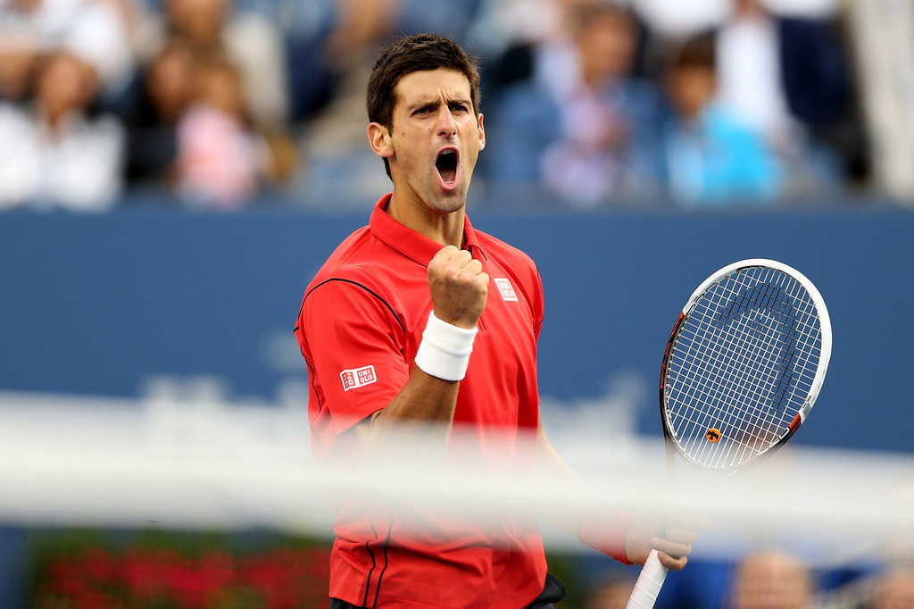 . Novak Djokovic of Serbia celebrates a point during his men\'s singles final match against Rafael Nadal of Spain on Day Fifteen of the 2013 US Open at the USTA Billie Jean King National Tennis Center on September 9, 2013 in the Flushing neighborhood of the Queens borough of New York City.  (Photo by Matthew Stockman/Getty Images)
