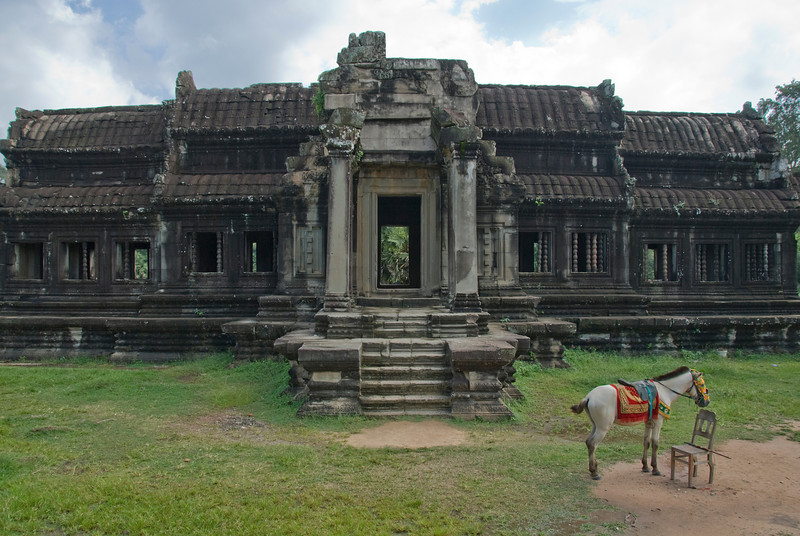 Horse in front of a side building in Angkor Wat complex