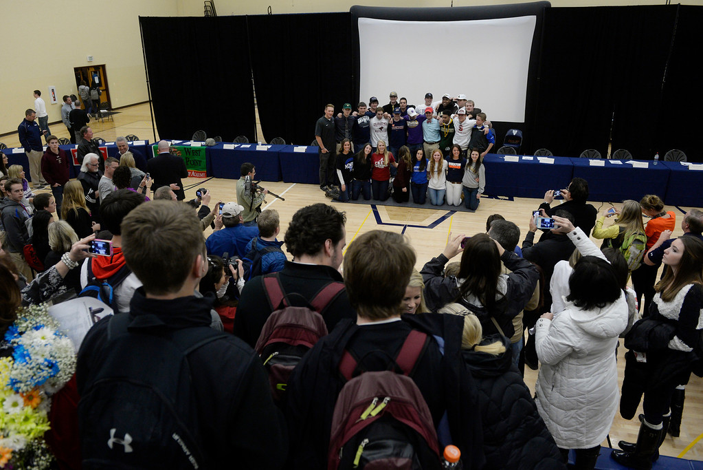 . HIGHLANDS RANCH, CO. - FEBRUARY 05: 25 Valor Christian High School athletes pose for a group photo after a National Letter of Intent Day assembly at Valor Wednesday morning, February 05, 2014. (Photo By Andy Cross / The Denver Post)