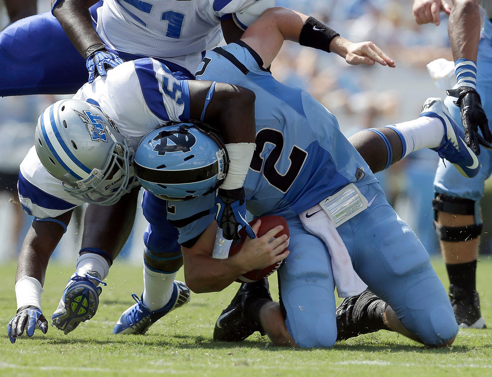 . North Carolina quarterback Bryn Renner (2) is sacked by Middle Tennessee\'s Iman Smith during the second half of an NCAA college football game in Chapel Hill, N.C., Saturday, Sept. 7, 2013. North Carolina won 40-20. (AP Photo/Gerry Broome)