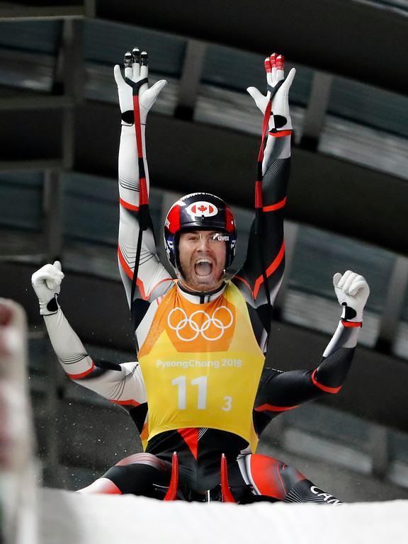 . Tristan Walker and Justin Snith, of Canada, react in the finish area after Canada won the silver medal in the luge team relay at the 2018 Winter Olympics in Pyeongchang, South Korea, Thursday, Feb. 15, 2018. (AP Photo/Andy Wong)