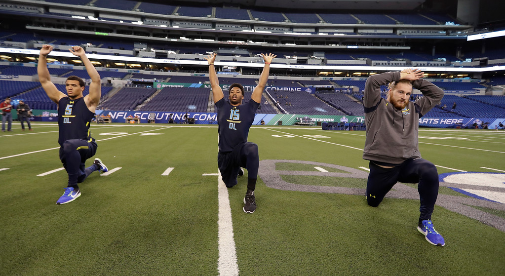 . LSU defensive end Tashawn Bower (5), Texas A&M defensive end Myles Garrett (15) and West Georgia defensive end Dylan Donahue (13) stretch at the NFL football scouting combine Sunday, March 5, 2017, in Indianapolis. (AP Photo/David J. Phillip)