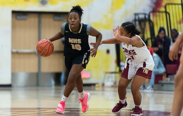 12/10/18 Wesley Bunnell | Staff New Britain girls basketball was defeated 52-39 at home against Newington on Thursday evening. Ashanti Frazier (10).