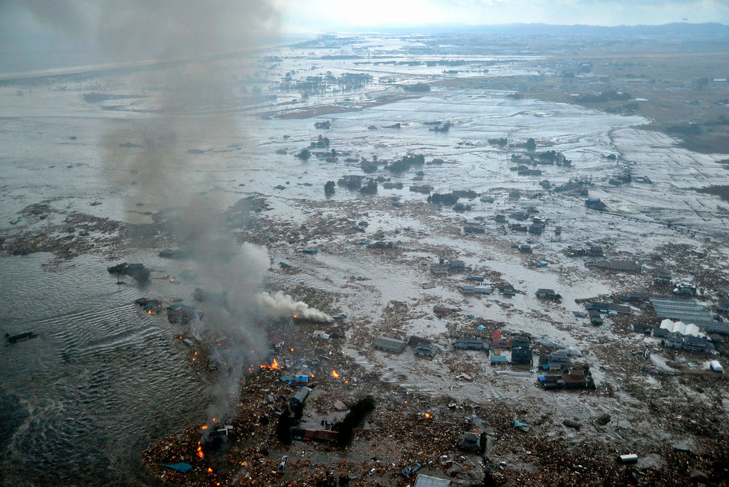 . Shores are submerged in Natori city, Miyagi prefecture (state), Japan, after a ferocious tsunami spawned by one of the largest earthquakes ever recorded, slammed Japan\'s eastern coasts Friday, March 11, 2011. (AP Photo/Kyodo News)