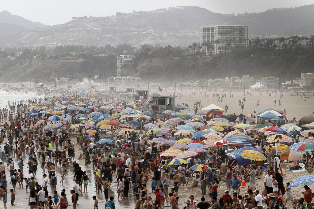 . A large crowd of people gathers at Santa Monica Beach in Santa Monica, California, June 30, 2011, amid the heat wave gripping the southwest US.    JONATHAN ALCORN/AFP/Getty Images