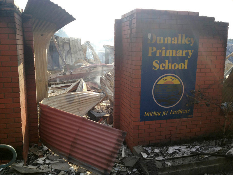 . A school, destroyed by a bush fire, lies in ruins in Dunalley about 40 kilometers (25 miles) east of Hobart January 5, 2013. In Australia\'s island state Tasmania, local media reported that over 100 homes had been destroyed and police said thousands of residents had been displaced by dozens of bush fires driven by record high temperatures on Friday.     REUTERS/Edith Bevin/Australian Broadcasting Corporation