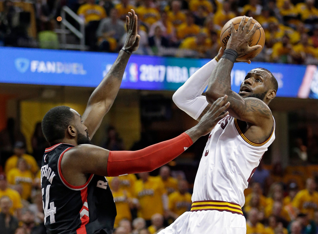 . Cleveland Cavaliers\' LeBron James, right, drives to the basket against Toronto Raptors\' Patrick Patterson (54) in the first half in Game 1 of a second-round NBA basketball playoff series,, Monday, May 1, 2017, in Cleveland. (AP Photo/Tony Dejak)