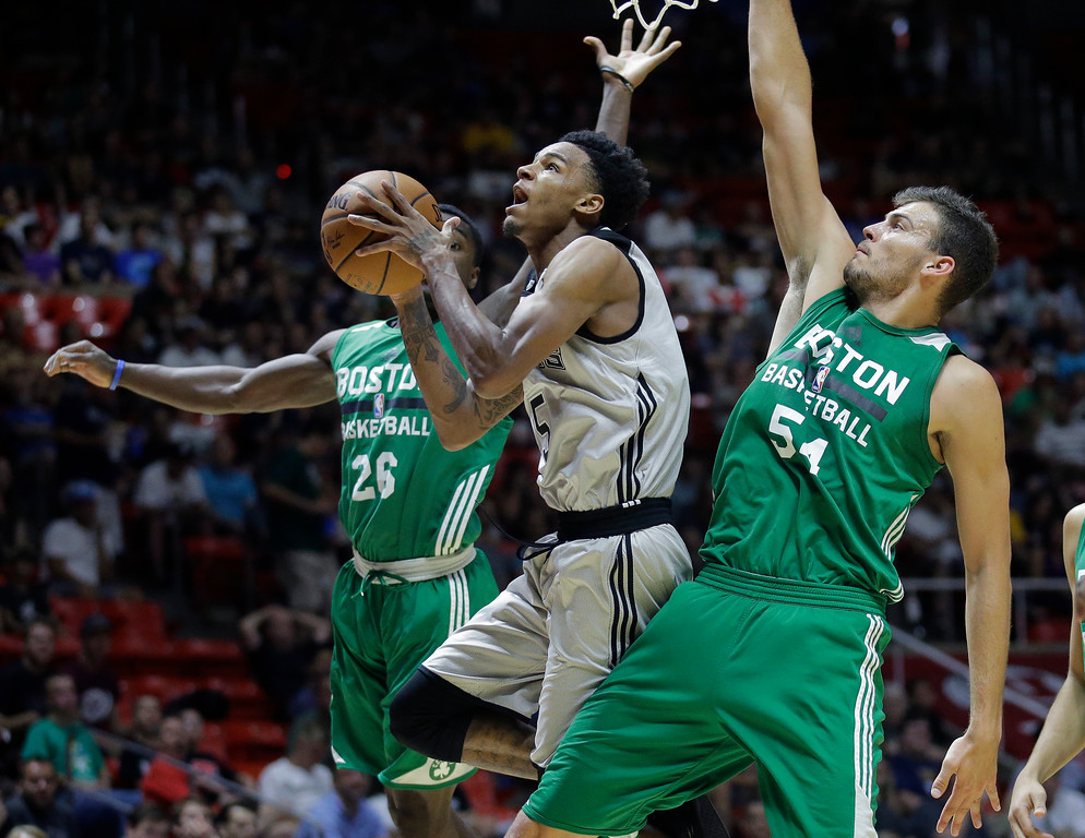 . San Antonio Spurs guard Dejounte Murray (5) goes to the basket as Boston Celtics\' Jabari Bird (26) and Ante Zizic (54) defend during the second half of an NBA summer league basketball game Wednesday, July 5, 2017, in Salt Lake City. (AP Photo/Rick Bowmer)