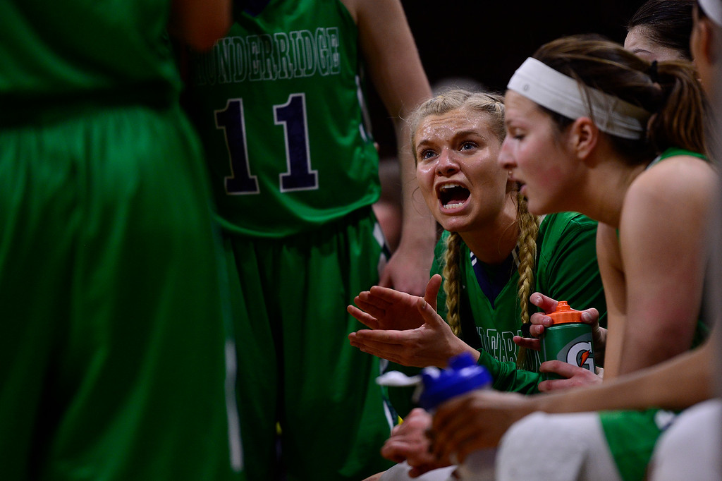 . Madison Ward (2) of ThunderRidge tries to fire up her team for the last 3 minutes of play at the Coors Events Center on March 12, 2016 in Boulder, Colorado. ThunderRidge defeated Highlands Ranch 47-32 to win the Class 5A Colorado State Basketball Championship. (Photo by Brent Lewis/The Denver Post)