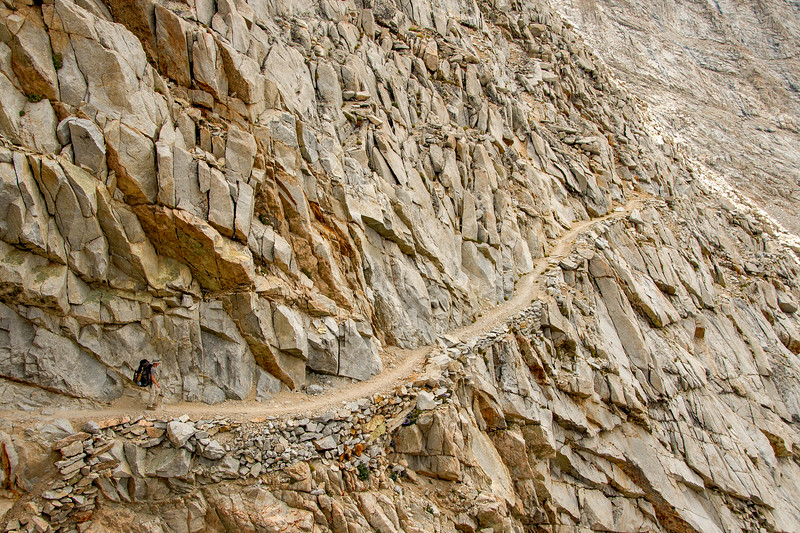 Ben hikes down the steep and narrow portion of the JMT on the south side of Forester Pass.