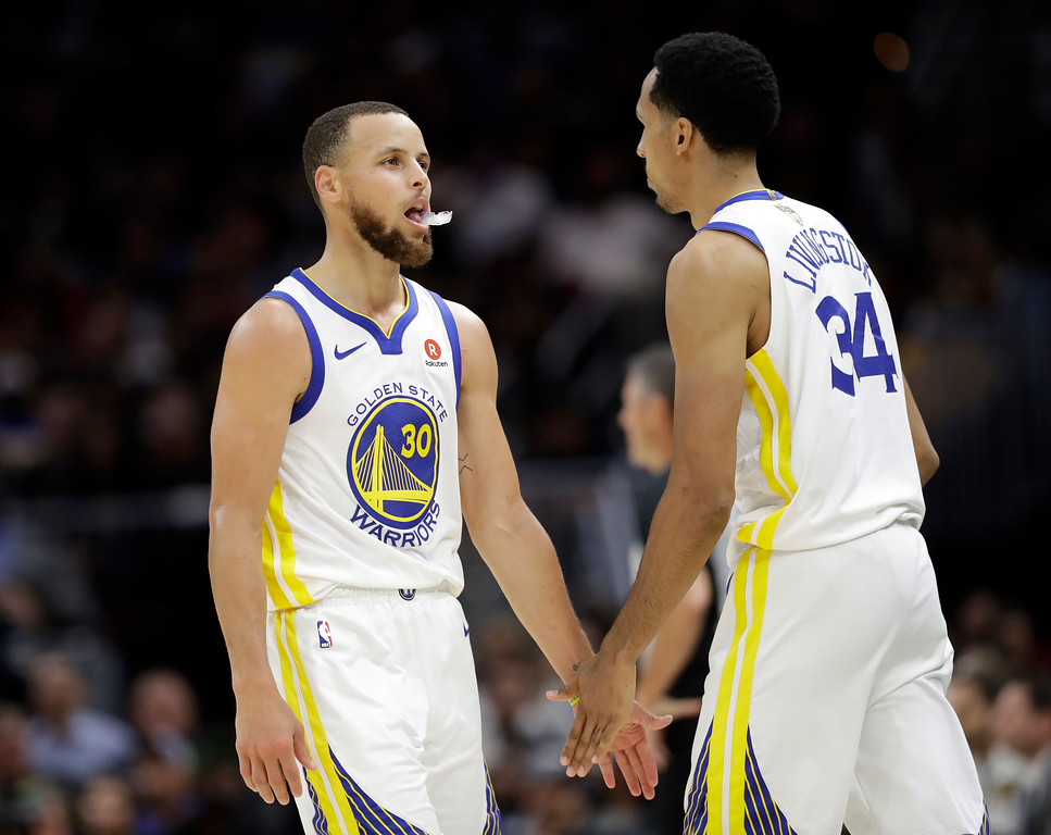 . Golden State Warriors\' Stephen Curry and Shaun Livingston react during the second half of Game 4 of basketball\'s NBA Finals against the Cleveland Cavaliers, Friday, June 8, 2018, in Cleveland. (AP Photo/Tony Dejak)