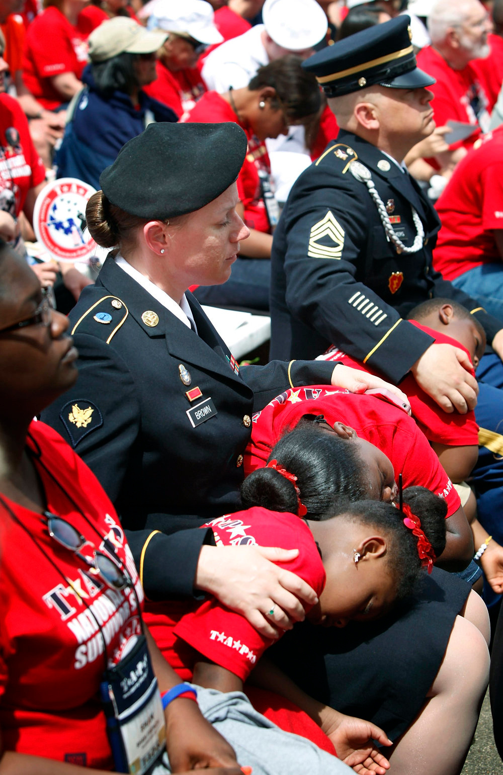 . Soldiers cradle sleeping children as U.S. President Barack Obama makes remarks during Memorial Day observances at Arlington National Cemetery in Arlington, Virginia, May 27, 2013. REUTERS/Jonathan Ernst