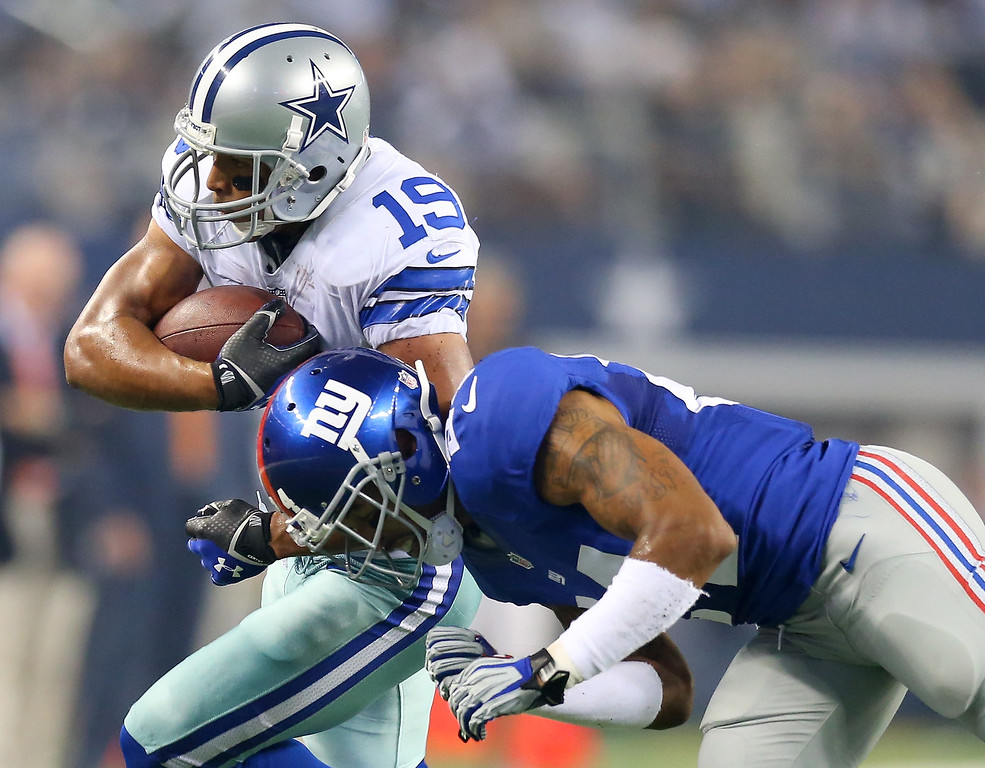 . Wide receiver  Miles Austin #19 of the Dallas Cowboys runs after a catch against Terrell Thomas #24 of the New York Giants in the first half on September 8, 2013 at AT&T Stadium in Arlington, Texas.  (Photo by Ronald Martinez/Getty Images)