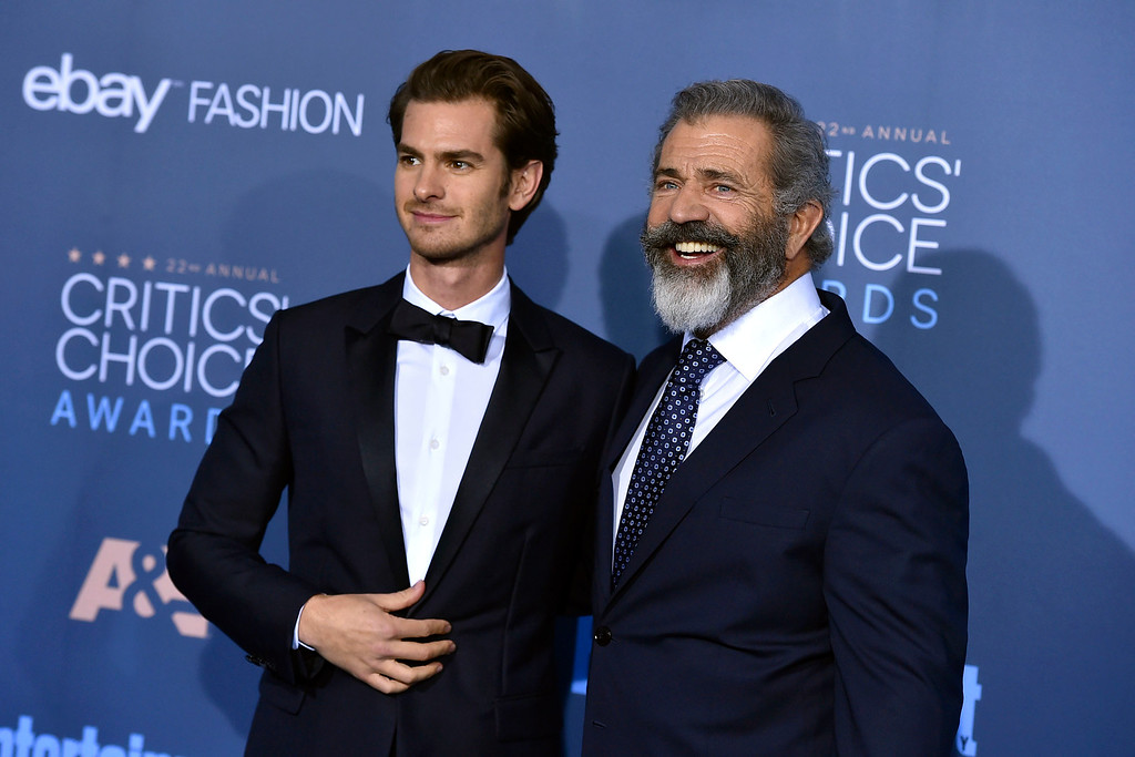 . Andrew Garfield, left, and Mel Gibson arrive at the 22nd annual Critics\' Choice Awards at the Barker Hangar on Sunday, Dec. 11, 2016, in Santa Monica, Calif. (Photo by Jordan Strauss/Invision/AP)