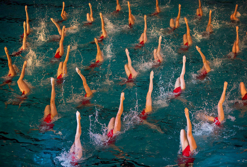 . In this Friday, Feb. 15, 2013 photo, North Korean synchronized swimmers perform at a mass synchronized swimming exhibition event in Pyongyang. (AP Photo/David Guttenfelder)