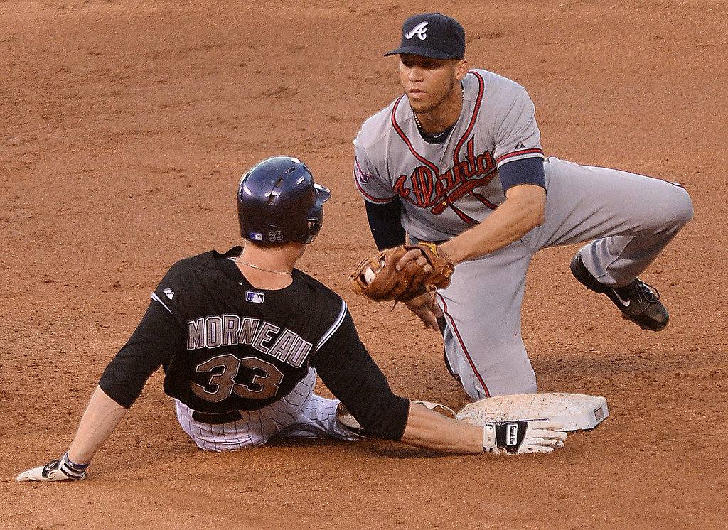 . Colorado batter Justin Morneau was tagged out at second base by Atlanta shortstop Andrelton Stimmons after Morneau tried to stretch a hit into a double in the third inning. The Colorado Rockies hosted the Atlanta Braves Tuesday night, June 10, 2014. (Photo by Karl Gehring/The Denver Post)