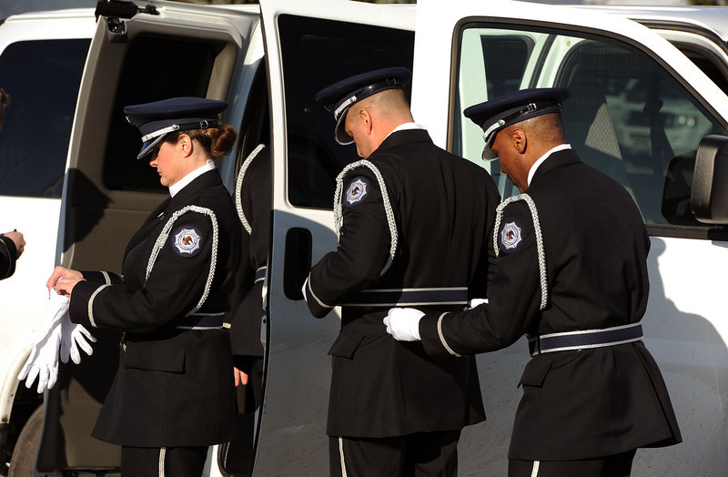 . Members of the Federal Bureau of Prisons Honor Guard from Englewood, CO get ready near their van in the parking lot before the public memorial service for Tom Clements on March 25, 2013.  Family, friends and corrections and police officers from all over the nation came to the public memorial service for Tom Clements  at New Life Church in Colorado Springs on March 25, 2013.  Hundreds turned out to pay their respects to Clements who was the executive director of the Colorado Department of Corrections, Tom Clements, was shot and killed as he opened the door to his Monument home on March 19, 2013.  (Photo By Helen H. Richardson/ The Denver Post)