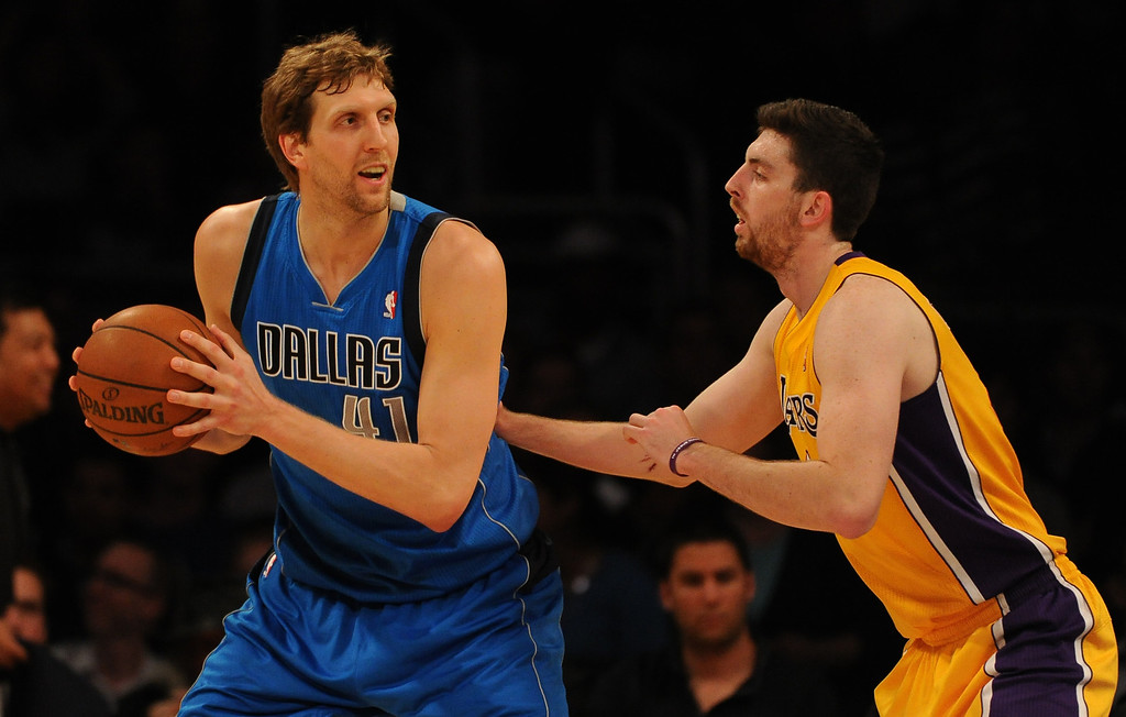 . Dallas Mavericks forward Dirk Nowitzki (41) controls the ball against Los Angeles Lakers forward Ryan Kelly in the first quarter during an NBA basketball game in Los Angeles, Calif., on Friday, April 4, 2014.  (Keith Birmingham Pasadena Star-News)