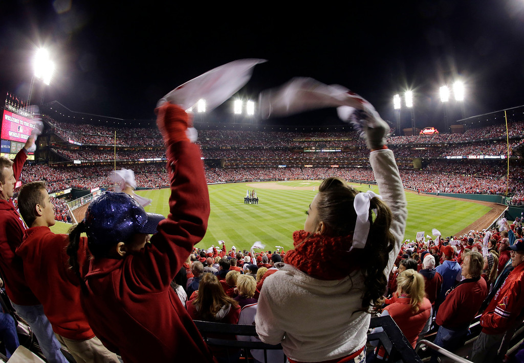 . Fans cheer before the start of  Game 4 of baseball\'s World Series between the Boston Red Sox and the St. Louis Cardinals Sunday, Oct. 27, 2013, in St. Louis. (AP Photo/Charlie Riedel)