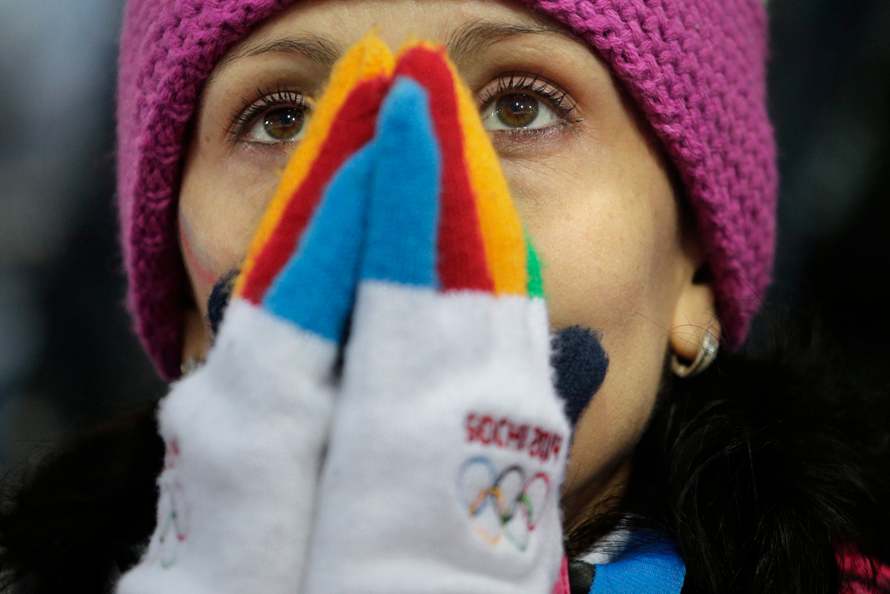 . A Russian spectator watches the women\'s biathlon 4x6k relay, at the 2014 Winter Olympics, Friday, Feb. 21, 2014, in Krasnaya Polyana, Russia. (AP Photo/Jae C. Hong)