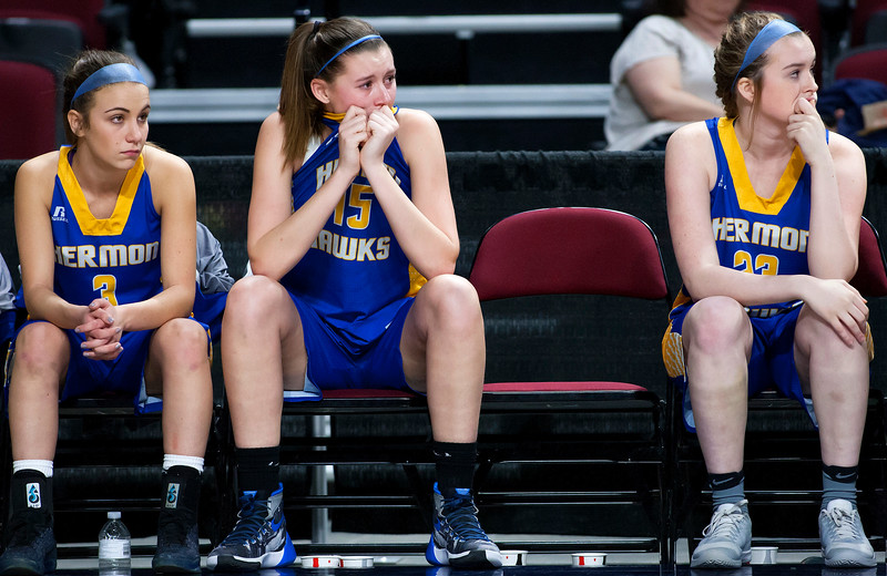 BANGOR, Maine -- 02/22/2017 -- Hermon's Emi Higgins (center) watches as time expires in over time to give her team the lose during their Class B girls basketball semifinal game against Houlton at the Cross Insurance Center in Bangor Wednesday. Ashley L. Conti | BDN
