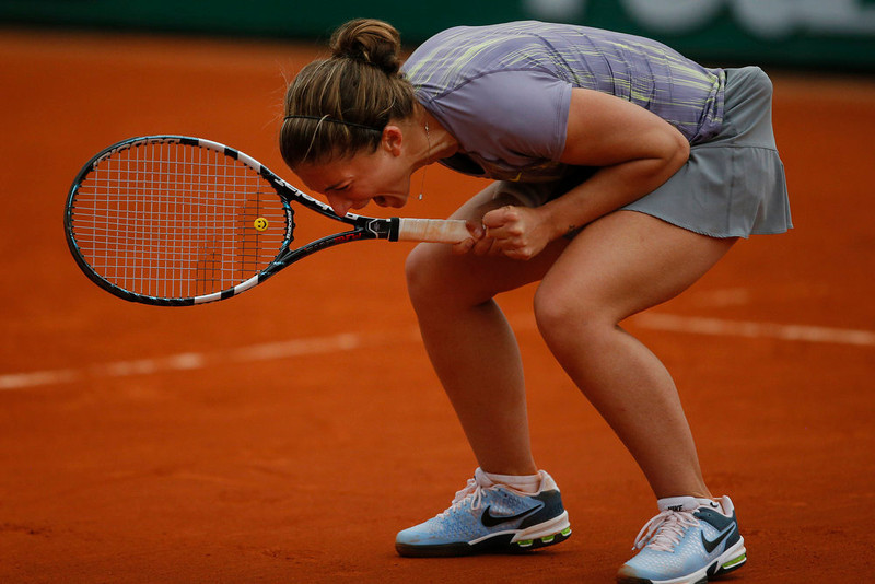 . Italy\'s Sara Errani celebrates winning against Carla Suarez Navarro of Spain in three sets 5-7, 6-4, 6-3, in their fourth round match at the French Open tennis tournament, at Roland Garros stadium in Paris, Sunday June 2, 2013. (AP Photo/Michel Spingler)