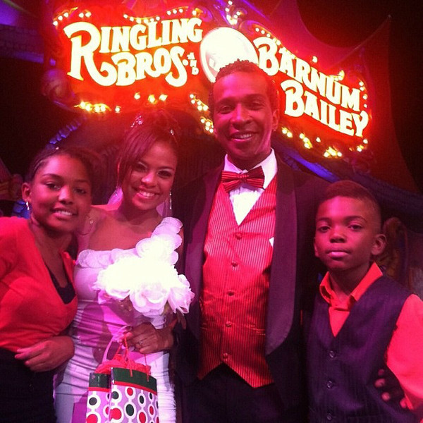 . Daniele and Andre McClain (center) are flanked by Andre\'s children after their surprise circus wedding at the Denver Coliseum on Oct. 2, 2012.  Ringling Bros. photo