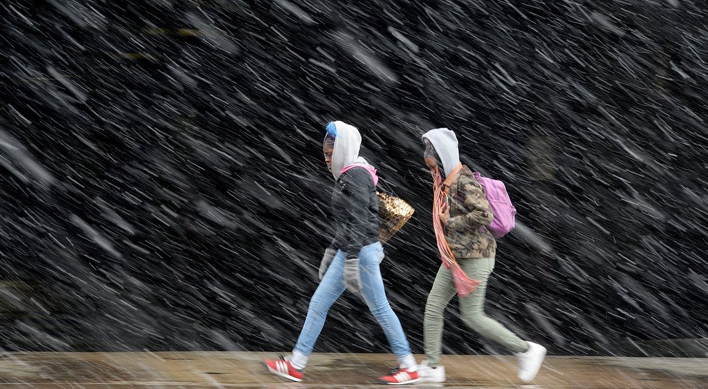 . DENVER, CO - FEBRUARY  25: Snow began to fall again  in the afternoon in Denver on Wednesday, February 25, 2015. Two walkers head north  up Broadway at Colfax Ave  in downtown Denver as the snow pounds down. (Photo by Cyrus McCrimmon/The Denver Post )