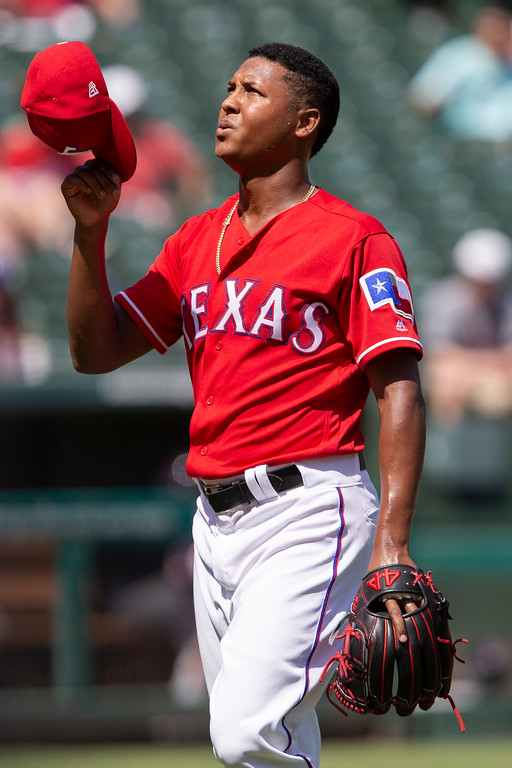 . Texas Rangers relief pitcher Jose Leclerc  gestures after the seventh inning of a baseball game against the Cleveland Indians, Sunday, July 22, 2018, in Arlington, Texas. (AP Photo/Sam Hodde)