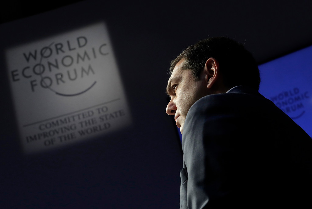 . Greek Prime Minister Alexis Tsipras arrives for a debate at the annual meeting of the World Economic Forum in Davos, Switzerland, Wednesday, Jan. 24, 2018. (AP Photo/Markus Schreiber)