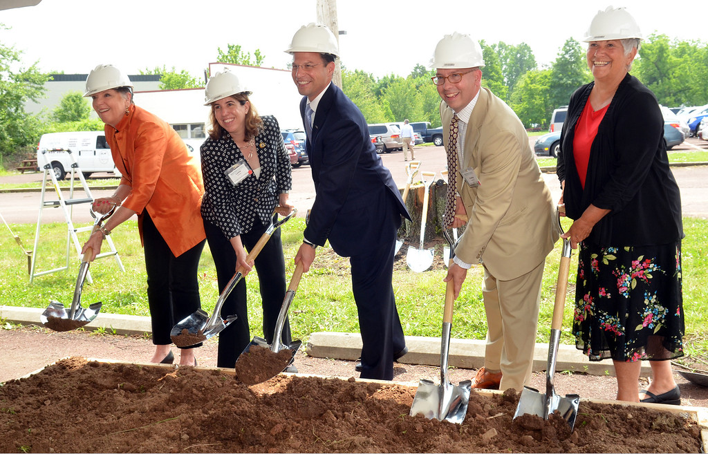 . Officials smile as they lift shovels at the groundbreaking for North Penn Commons in Lansdale.   From left, Timi Kirchner,  Lansdale Borough Manager, Leslie Richards, Montgomery County Commissioner, Josh Shapiro, Chariman, Montgomery County Commissioners, Andy Szekely, Lansdale Mayor, Kathy Phifer, Montgomery County Director of Housing and Community Development.    Tuesday, June 10, 2014.   Photo by Geoff Patton