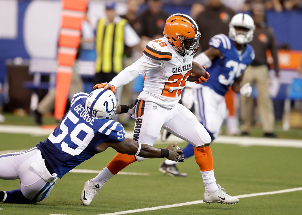. Cleveland Browns running back Duke Johnson (29) pushes off Indianapolis Colts inside linebacker Jeremiah George (59) during the second half of an NFL football game in Indianapolis, Sunday, Sept. 24, 2017. (AP Photo/Darron Cummings)