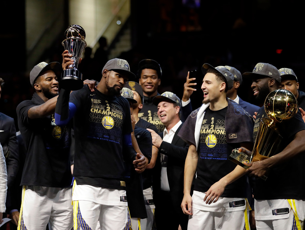 . Golden State Warriors\' Kevin Durant, second from left, celebrates after the Warriors defeated the Cleveland Cavaliers 108-85 in Game 4 of basketball\'s NBA Finals to win the NBA championship, Friday, June 8, 2018, in Cleveland. (AP Photo/Tony Dejak)