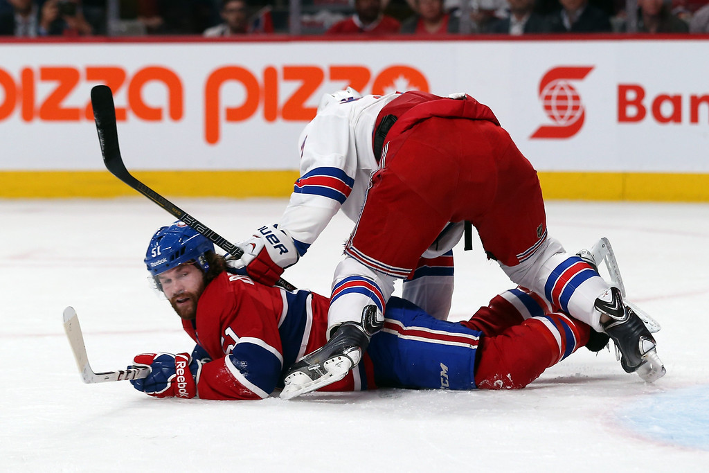 . Ryan McDonagh #27 of the New York Rangers checks David Desharnais #51 of the Montreal Canadiens during the first period in Game Two of the Eastern Conference Final during the 2014 Stanley Cup Playoffs at Bell Centre on May 19, 2014 in Montreal, Canada.  (Photo by Bruce Bennett/Getty Images)