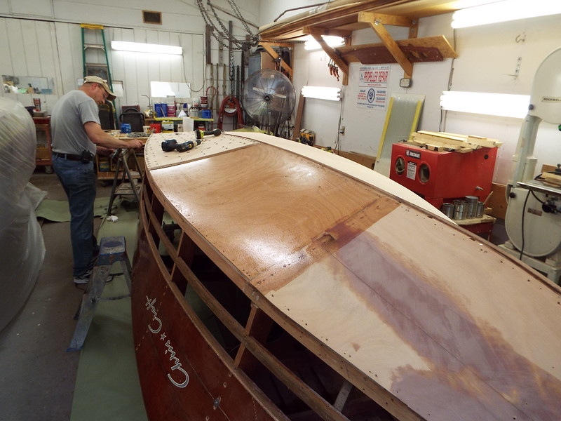 Second piece of bottom skin on the port side with epoxy applied.