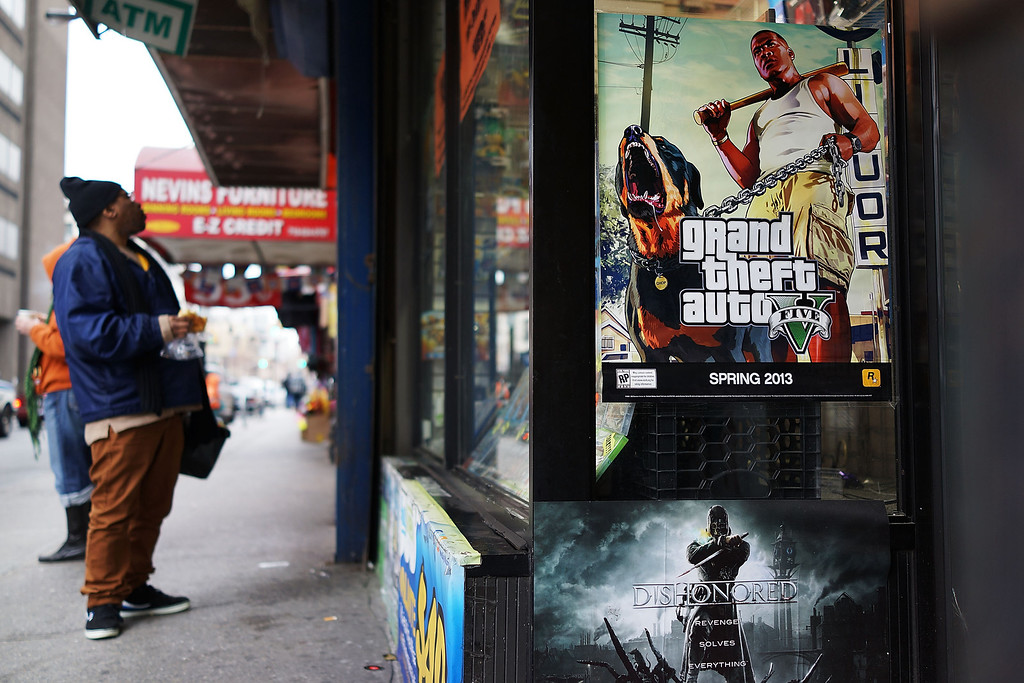 . NEW YORK, NY - JANUARY 11:  An advertisement for the new Grand Theft Auto is displayed outside of a gaming store on January 11, 2013 in New York City.  Following the shootings of children at a elementary school last month in Connecticut, numerous politicians and activists have begun to focus on violence in video games and films. US vice-president Joe Biden is meeting with games industry representatives today to discuss graphic violence, often with guns, in many of today\'s most popular video games.  The administration is also expected to address violence in the film industry as well.  (Photo by Spencer Platt/Getty Images)
