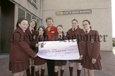 Pupils from St Mary's high school Newry present Sally Lynch with a cheque for £1300 which was raised through Number day at the school. 06W8N2