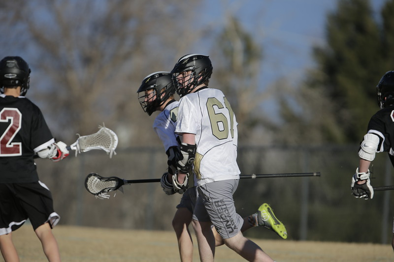 JPM0017-JPM0017-Jonathan first HS lacrosse game March 9th.jpg