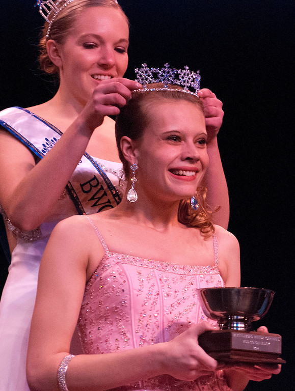 """. Kayla Rice/Reformer 2013 Winter Carnival Queen Alison Cornellier crowns Nicole Koziara as the \""""Fan Favorite\"""" during the 2014 Brattleboro Winter Carnival Queen\'s Pageant on Friday evening."""