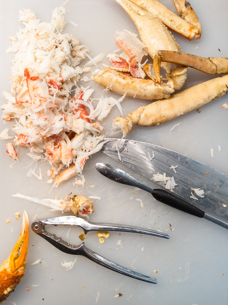 snow crabs cracker and meat on cutting board.jpg