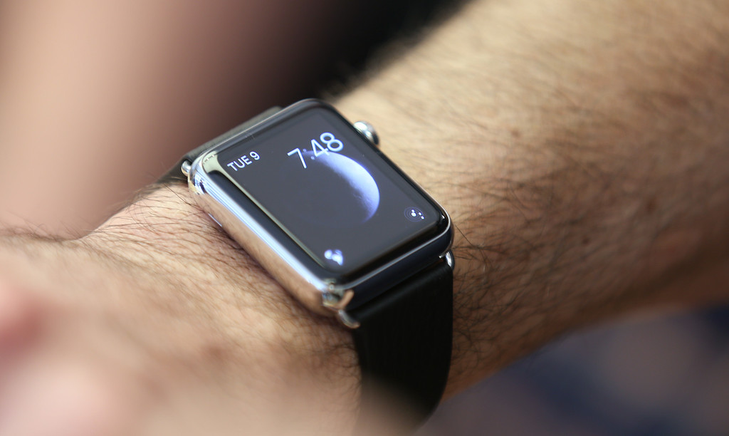 . A customers wears an Apple Watch as the public have its first chance to see, touch and pre-order the watch in Sydney, Friday, April 10, 2015. Prices start at $349, but can go as high as $17,000 for a luxury edition in gold. (AP Photo/Rick Rycroft)