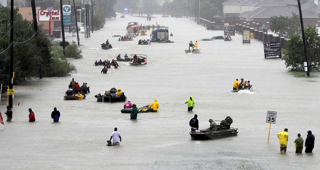 . Rescue boats fill a flooded street as flood victims are evacuated as floodwaters from Tropical Storm Harvey rise Monday, Aug. 28, 2017, in Houston. (AP Photo/David J. Phillip)
