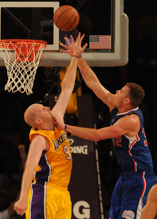 . Lakers#9 Chris Kaman blocks a shot by Clippers#32 Blake Griffin in the 4th quarter. The Los Angeles Lakers defeated the Clippers 116 to 103 in the opening game of the season at Staples Center. Los Angeles, CA. 10/29/2013. photo by (John McCoy/Los Angeles Daily News)