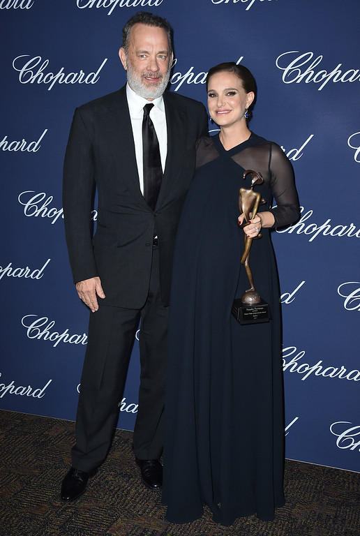 ". Natalie Portman, winner of the Desert Palm Achievement actress award for ""Jackie,\"" poses backstage with presenter Tom Hanks at the 28th annual Palm Springs International Film Festival Awards Gala on Monday, Jan. 2, 2017, in Palm Springs, Calif. (Photo by Jordan Strauss/Invision/AP)"